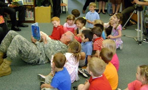 "Major General John W. ""Bill"" Libby, US Army (Ret.) reads with children at a Pre-K program in Bangor, ME, during an event on the importance of investing in high-quality early education."